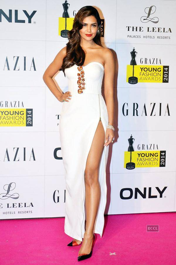 Esha Gupta flaunts long legs in thigh-high slit gown